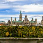 Stunning autumn view of Parliament Hill across the Ottawa River in Ottawa, Canada